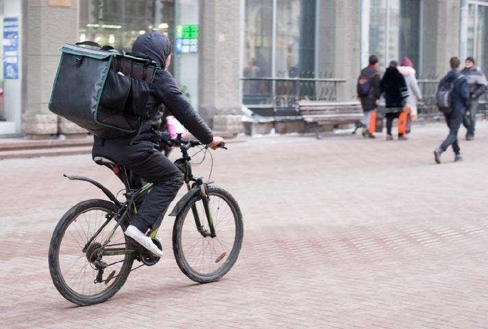 Man on a bike delivering food