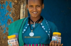 A beekeeper with honey for sale in Ethiopia's Amhara region. Credit: Bees for Development