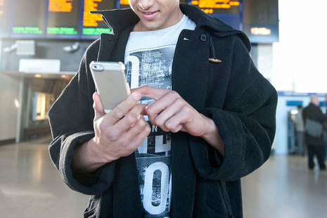 Person using phone at rail station