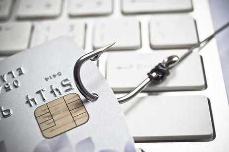 Illustration of phishing email: keyboard and fishing hook in credit card