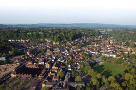 Aerial view of land and town