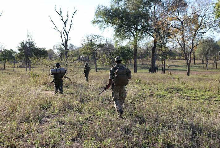 Local park rangers and UK soldiers patrol Nkhotakota and Majete Wildlife Reserves in Malawi to combat poaching.