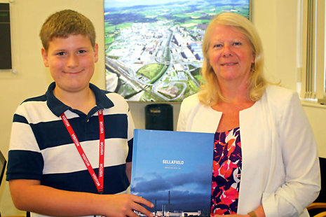 Samuel Boardman being presented with a Sellafield Ltd book