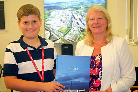 Samuel Boardman being presented with a Sellafield Ltd book