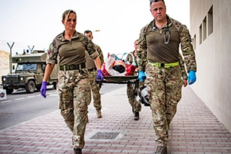 Members of the Joint Medical Group use a stretcher to carry a simulated casualty.