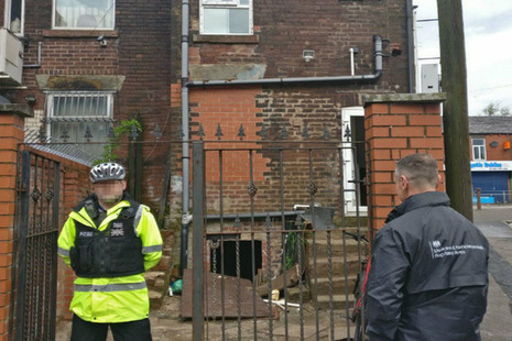 Police officer and MHRA staff member outside house
