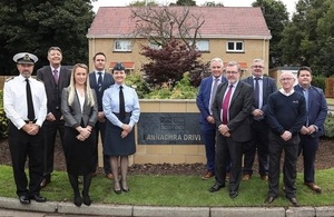 Secretary of State for Scotland, David Mundell MP; Captain of the Base, Captain Craig Mearns; Air Commodore Wendy Rothery, DIO's Head of Accommodation, with staff from DIO and Amey.