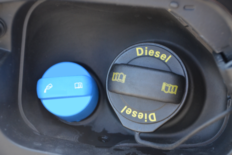 Image of a diesel fuel cap and AdBlue cap on a lorry