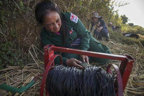Female deminer at work in Laos