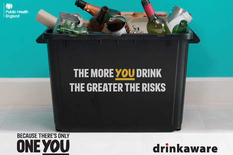 Plastic box containing lots of empty bottles, featuring the message 'the more you drink, the greater the risks'.