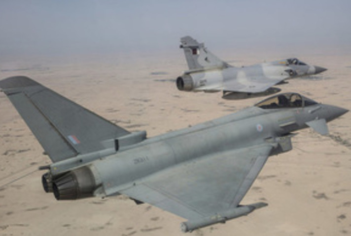 RAF Typhoon (foreground) and a QEAF Mirage jet taking part in a joint exercise held by the Emir of Qatar's Air Force.