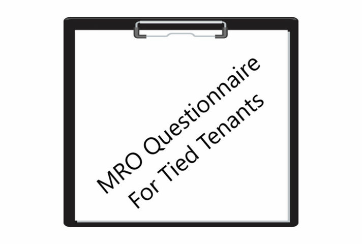 Clipboard with MRO questionnaire written in the middle