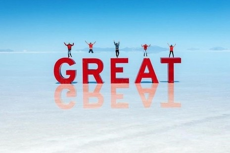 People jumping on GREAT sign on Bolivian salt flats