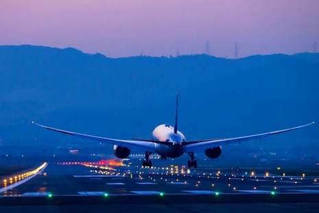 Boeing airplane lands at night