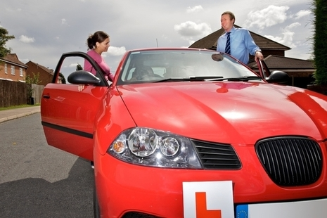 Image of a learner driver and driving instructor