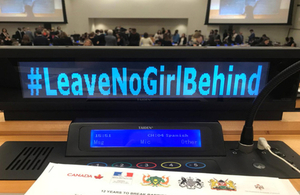 "Photo of computer displaying text ""#LeaveNoGirlBehind at UNGA 2018"