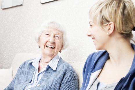 Older lady talking to carer