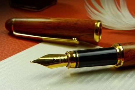 Pen quill and paper