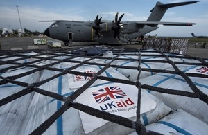 UK aid being unloaded at the international relief centre at Balikpapan. Crown copyright.