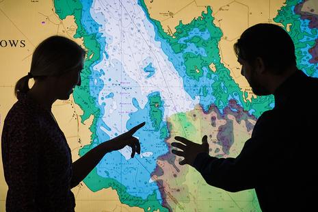 Two users analysing marine geospatial data