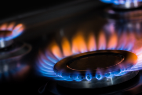 A lit flame no a gas hob.