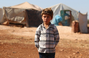 An internally displaced boy stands near his temporary shelter in rural Idlib, Syrian, August 2018. Picture: UNICEF/Amer Al Shami