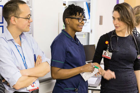 Doctors chatting in hospital corridor