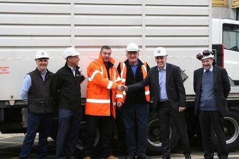 Magnox Managing Director Tony Moore shaking Adrian Owen, Wylfa Transport Manager's, hand.