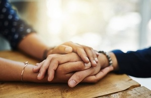A person holding another persons hand