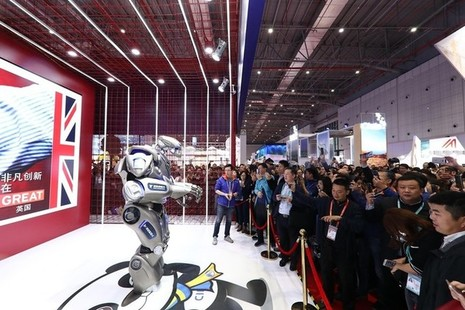Titan the Robot entertains crowds at the UK pavilion at the Chinese International Import Show