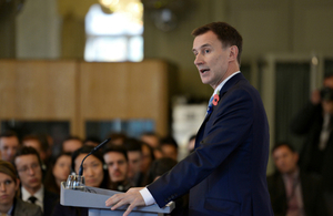 Landscape of Jeremy Hunt doing a speech