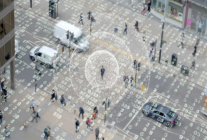 A city square with cars and people with an overlay of transparent data