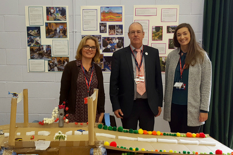 Minety School teacher Maria Madeley, left, with Garry Packer and Emma Grayson of Highways England and her pupils' bridge design at the British Science Association's How Real Stuff Works event at Malmesbury School