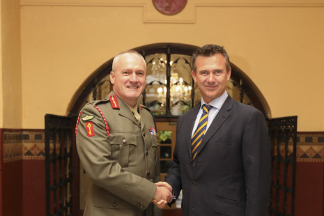 Minister for the Armed Forces Minister Mark Lancaster shakes hands with His Excellency the Governor of Gibraltar