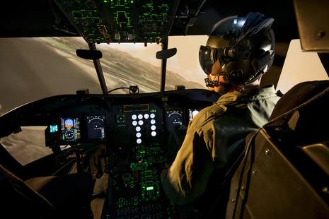 RAF pilot using the Chinook training system