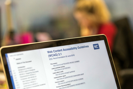 A laptop screen showing the Web Content Accessibility Guidance website