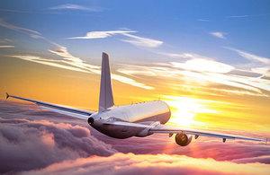 Plane flying over the sunrise
