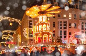 Snowy Christmas scene with merry go round