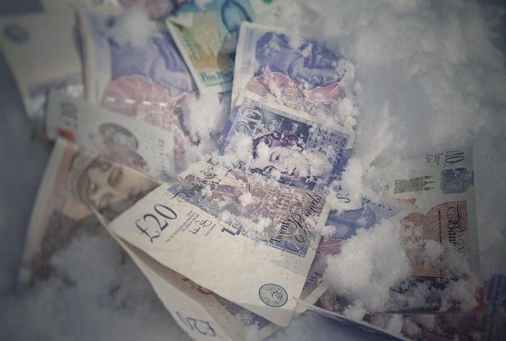 Money frozen in snow