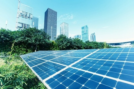 Solar panels in foreground of cityscape