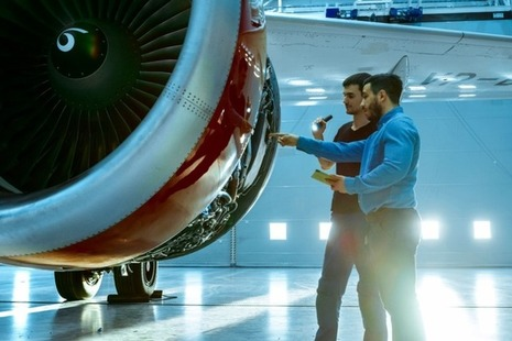 Maintenance engineers diagnose a jet engine