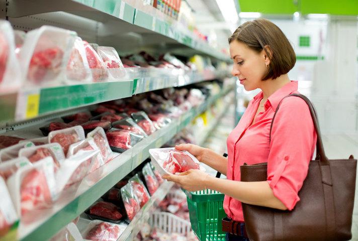 Woman choosing food at the supermarket