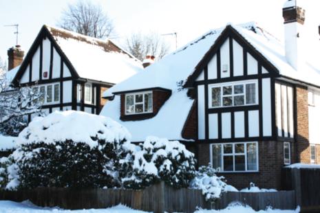 Detached mock Tudor house in snow