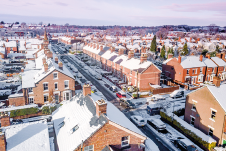 Aerial view of suburban streets in the snow.
