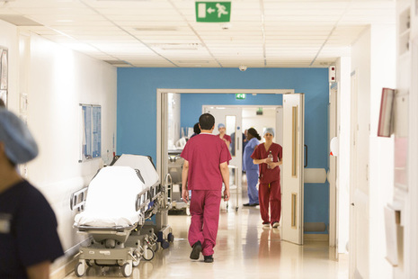 Nurses walking through a hospital corridor.