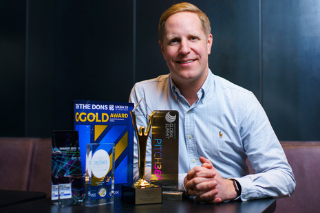 Christer Holloman pictured with a series of awards Divido has attracted for its innovative and disruptive finance platform and business model.