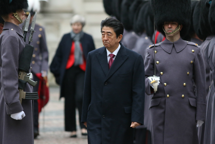 Japanese PM walking along a row of soldiers