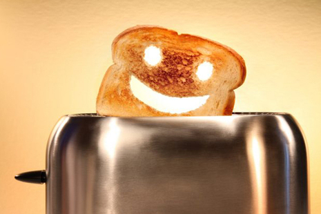Toast with smiley face popping out of toaster