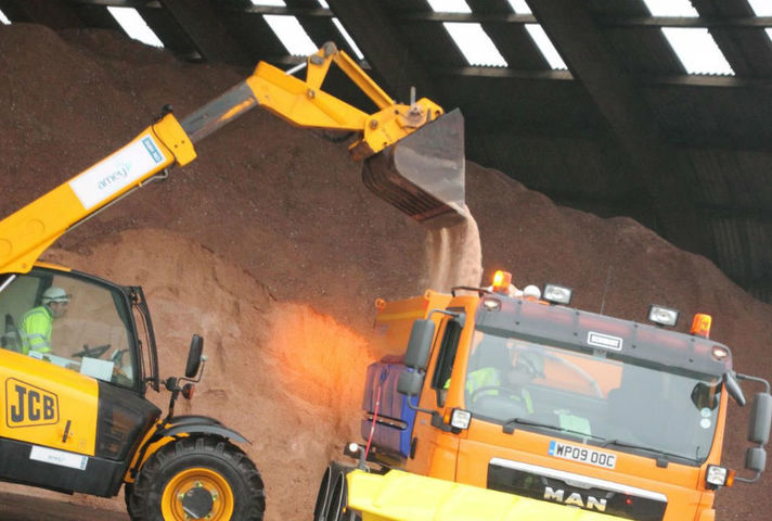 Salt being loaded onto a gritter