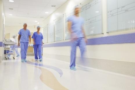 Doctors walking along hospital corridor
